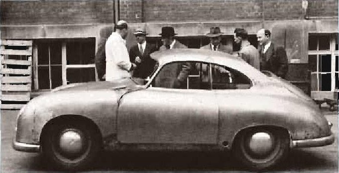 One of the first Stuttgart, steel-bodied Porsches. Built by Reutter, you can still see the seams. That's Professor Porsche standing behind the front door post. (Photo courtesy Porsche AG)
